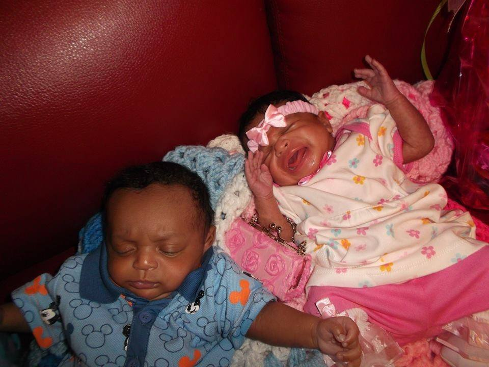 IL twins Arianna crying on blanket