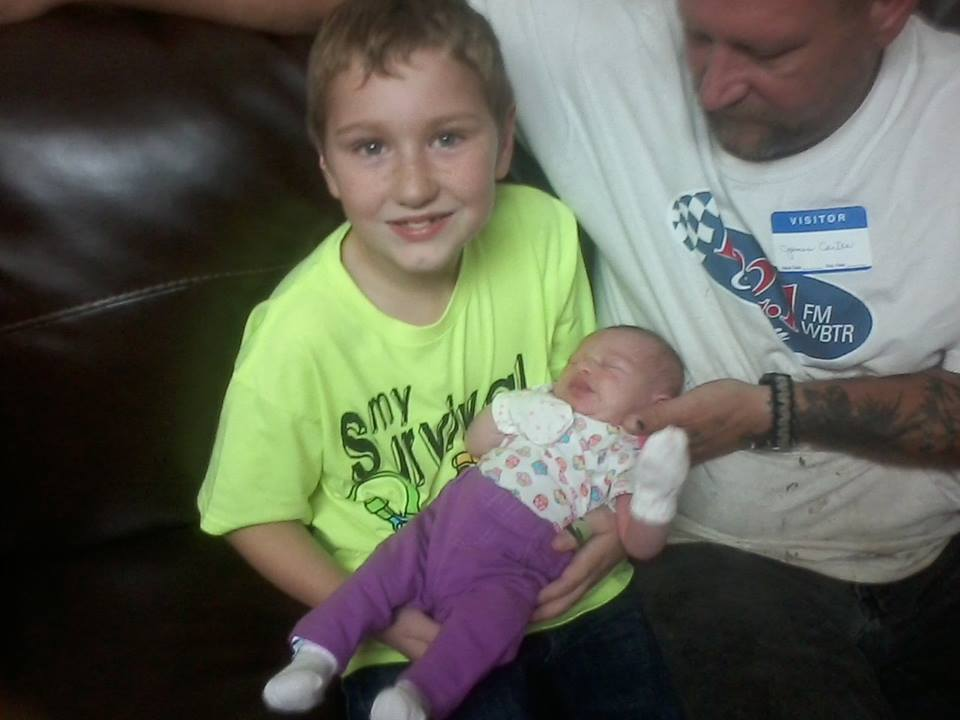 Cartee Timothy Cartee holding KahLyn for the first time sept 23rd 2014