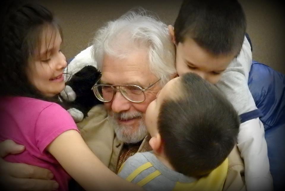 Stanley children hugging on their dad