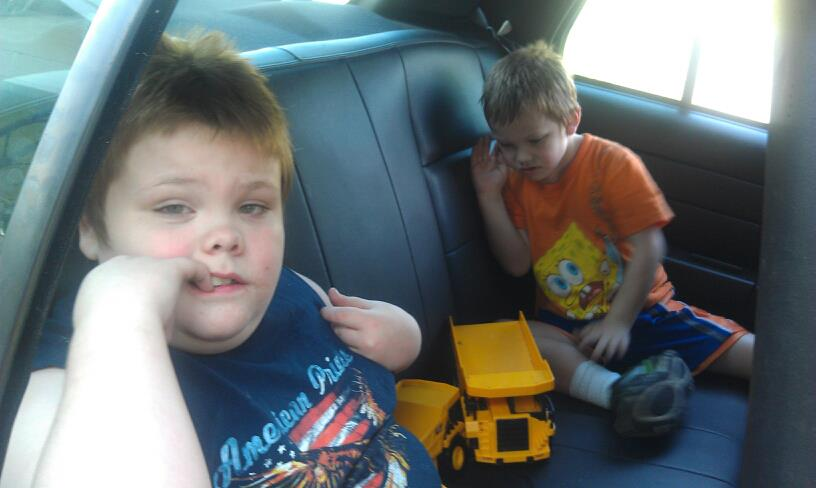 Dawn Cullins boys in police car