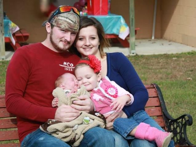 Keshia and family smiling babies
