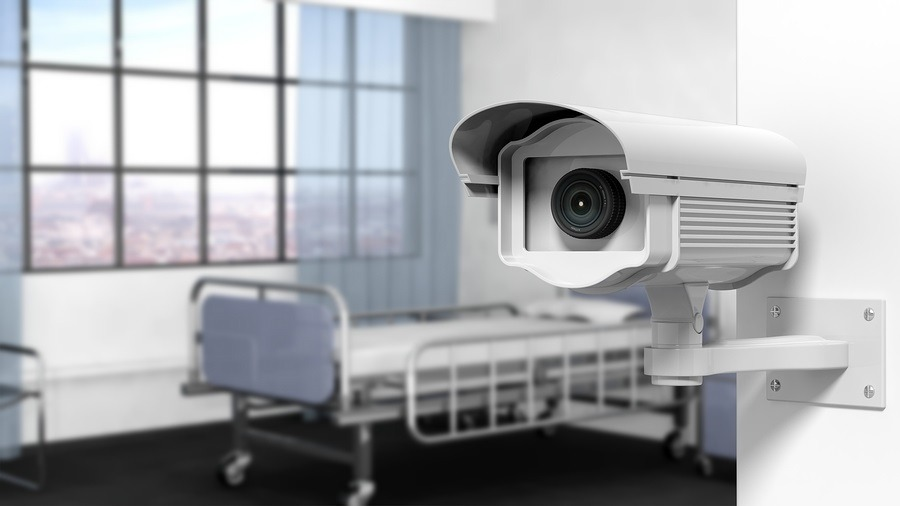 Security surveillance camera on wall in a hospital room