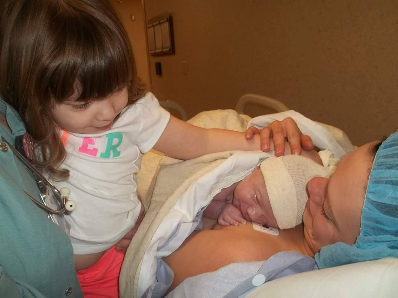 Holly with new baby and big sister
