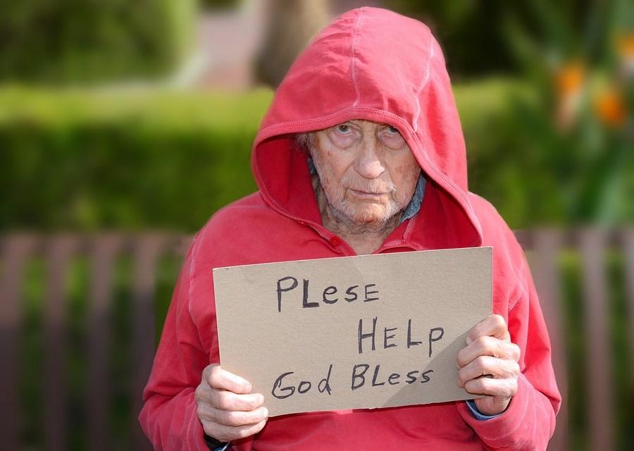 Sad Image of a senior Homeless man In Park