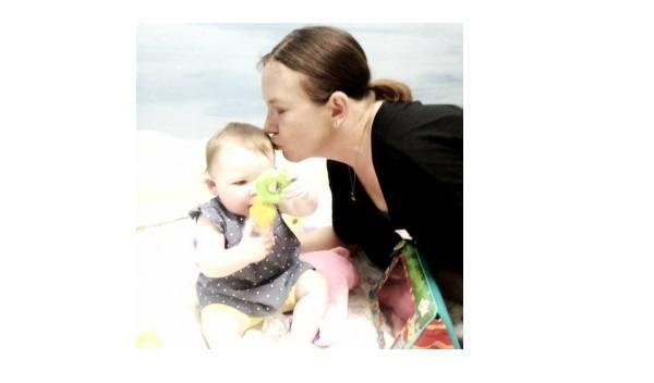 Wallace-mom-kissing-baby-FB