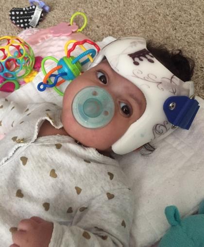 Glazier baby in helmet
