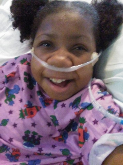 Jasmin smiling in hospital