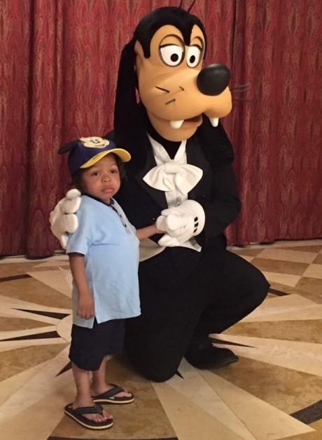 Malik with Pluto
