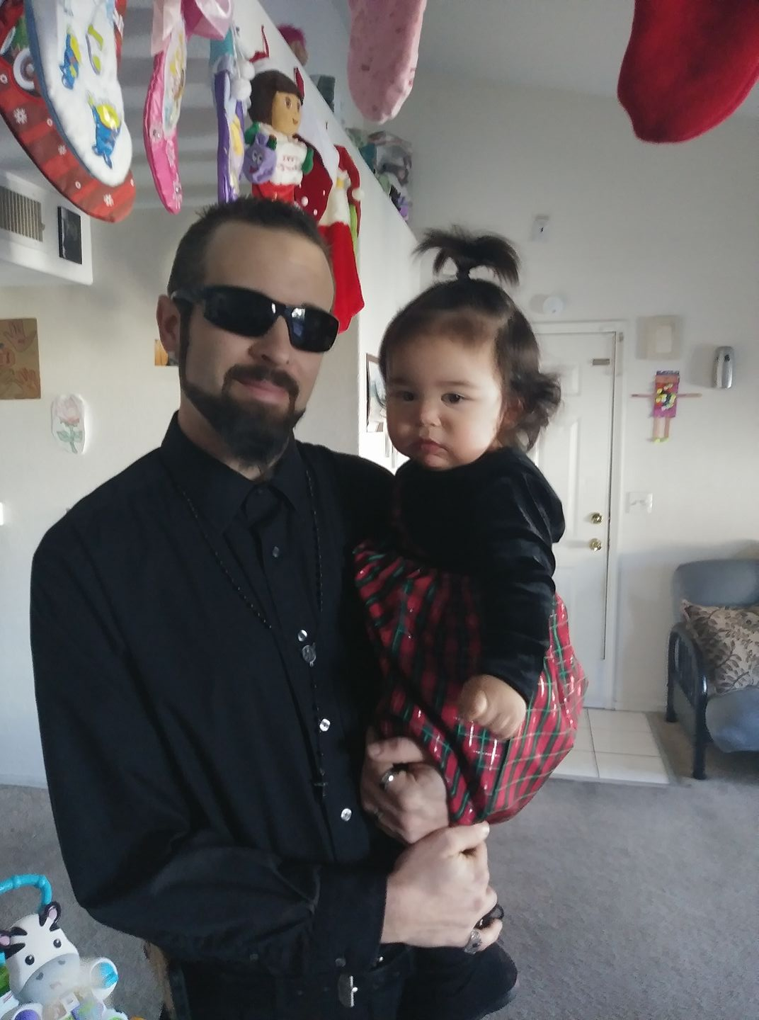 Father Jeff Shoar with baby Ny'tallieya photo