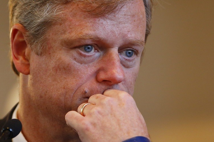 BOSTON - SEPTEMBER 24: Candidate for Governor Charlie Baker watches a question on a video monitor during a debate focused on human services at Faneuil Hall in Boston, Massachusetts September 24, 2014. (Photo by Jessica Rinaldi/The Boston Globe via Getty Images)