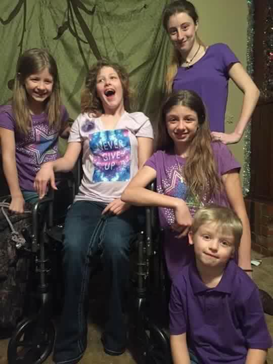 Searcy family portrait with wheelchair