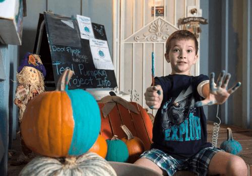 Erin Zach painting pumpkins