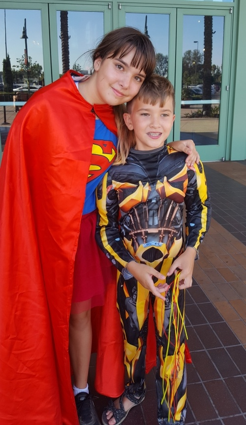 Erin kids in superhero costumes