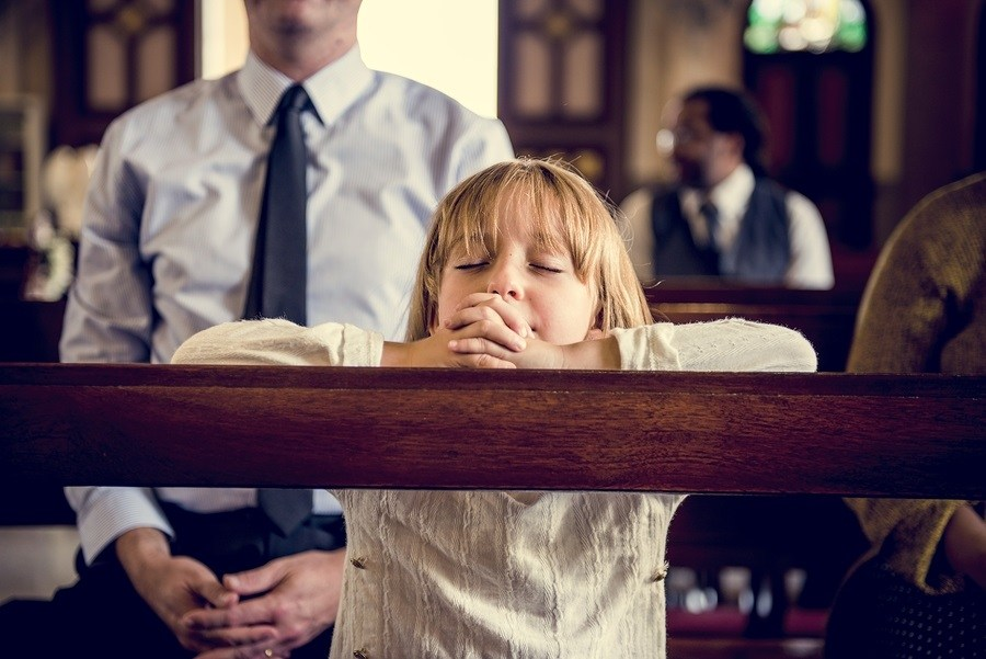 Little Girl Praying in Church photo
