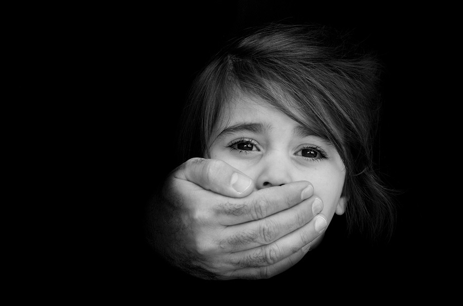 Strong male hands cover little girl face with emotional stress pain afraid call for help struggle terrified expression.Concept Photo of abduction missing kidnappedvictim hostage abused child
