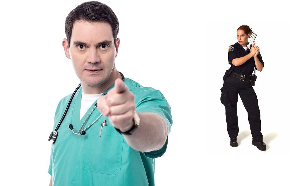 Frustrated male physician pointing his finger to camera